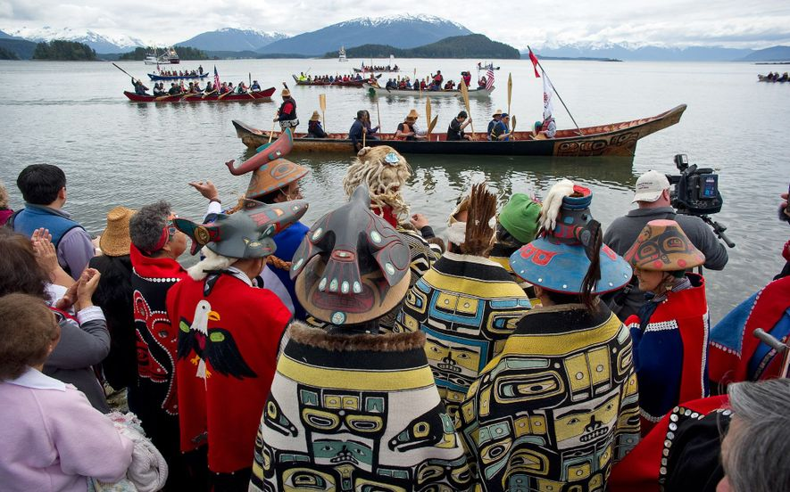 During a Coming Ashore ceremony, members of the Tlingit Auke Bay clan greet canoes arriving at the Auke Recreation Area beach in Juneau, Alaska.