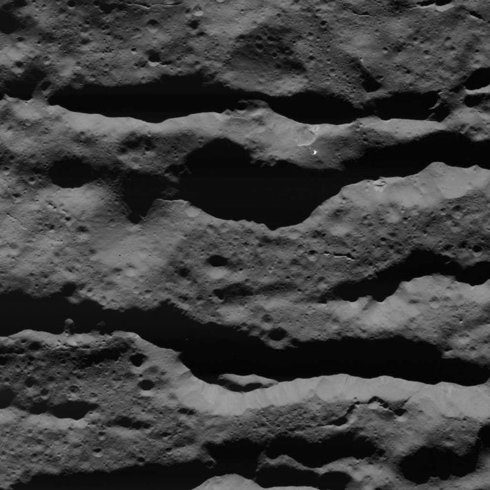 Deep fractures in Occator Crater were imaged by NASA's Dawn spacecraft on July 31, 2018, from ...