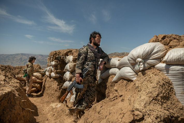 Abdul Wahab, 28, a former Taliban fighter who joined an anti-Taliban militia, stands guard at a ...
