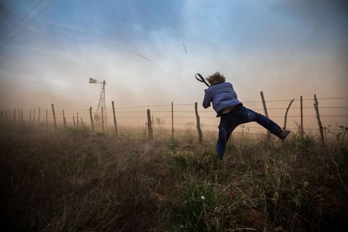 Nick does his best to hold his ground during a blinding sandstorm in Childress, Texas. This ...