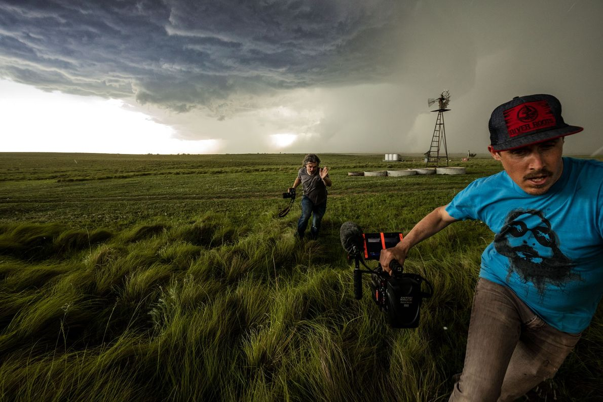 Nick and Skip Armstrong sprint back to the car as marble-size hail begins to fall over ...