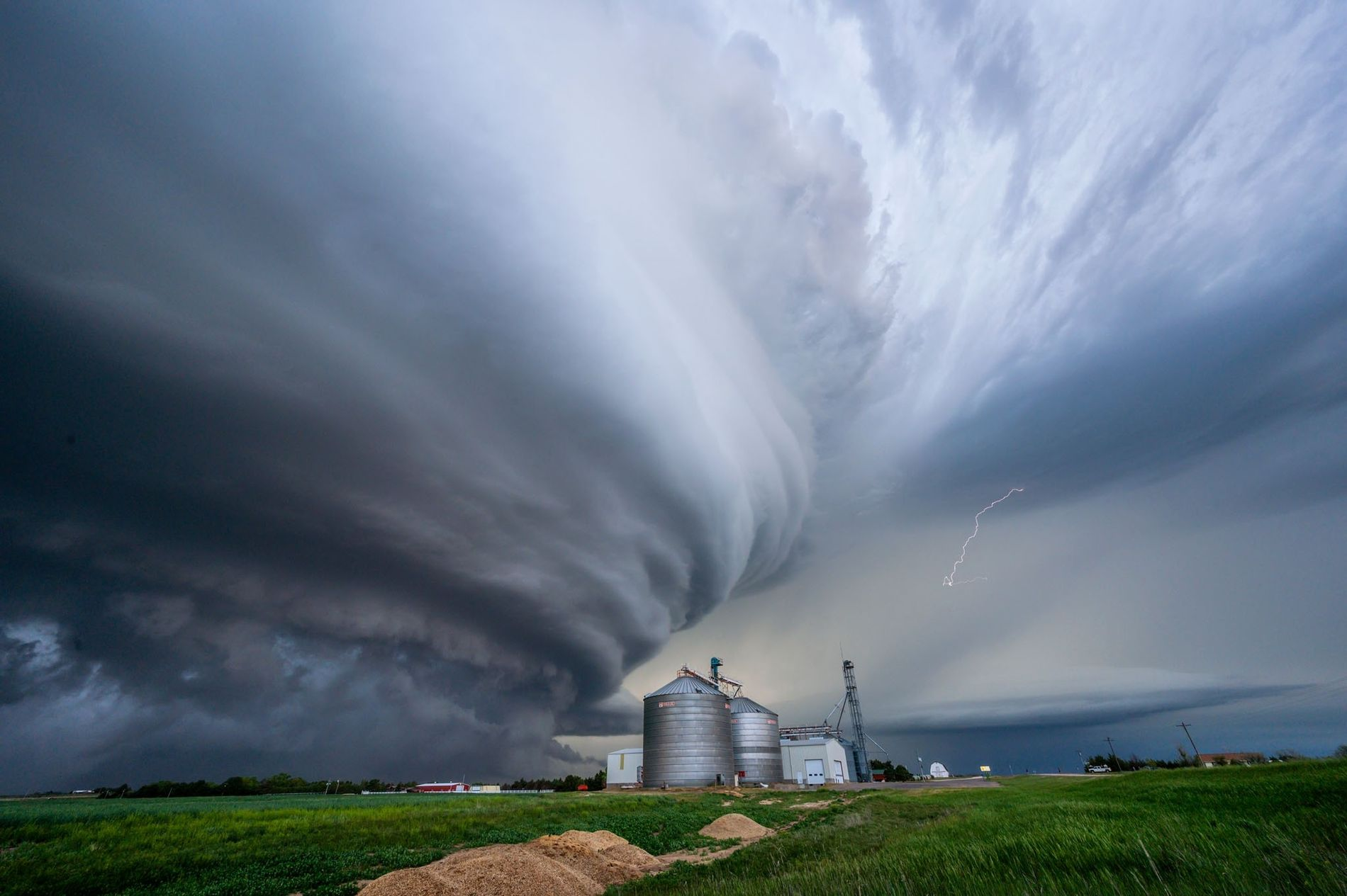 A 'supercell' storm towers over a farm grain elevator.