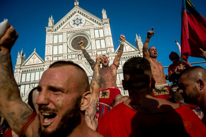 The Rossi of Santa Maria Novella celebrate their victory in a 2019 semifinal match in front ...