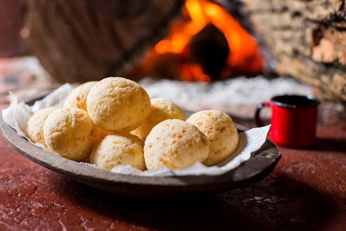 Pao de queijo, or Brazilian cheese bread made with tapioca flour, has a chewy texture and ...