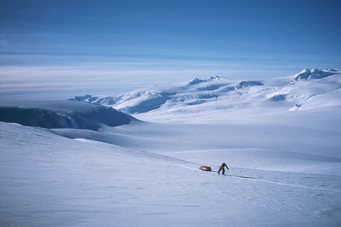 A hiker pulls a sled though the Southern Patagonia Icefield, which covers over 5,000 square miles ...