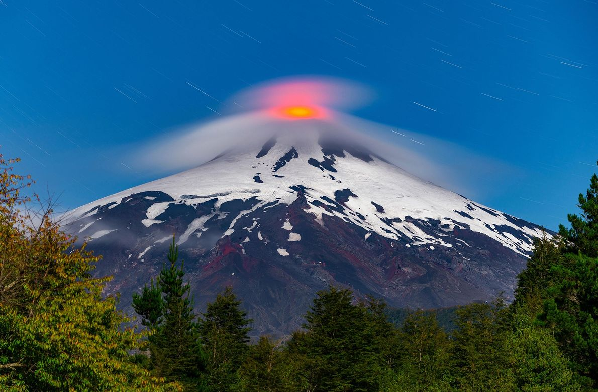 Lava bubbles up at the 9338-foot summit of Villarrica volcano around 400 miles south of Santiago, ...