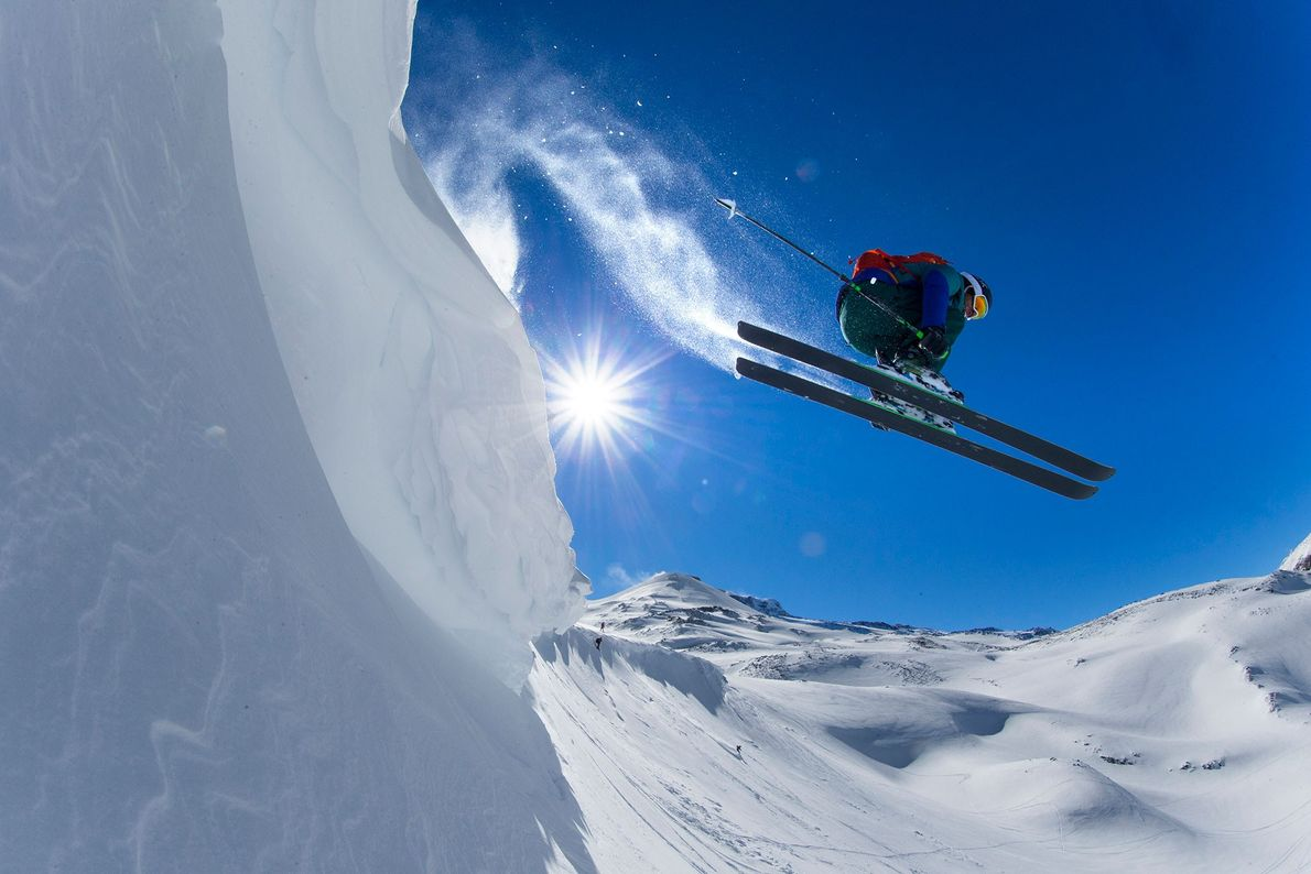 A professional freeskier shoots off a peak at the Nevados de Chillán Ski Resort, which runs ...