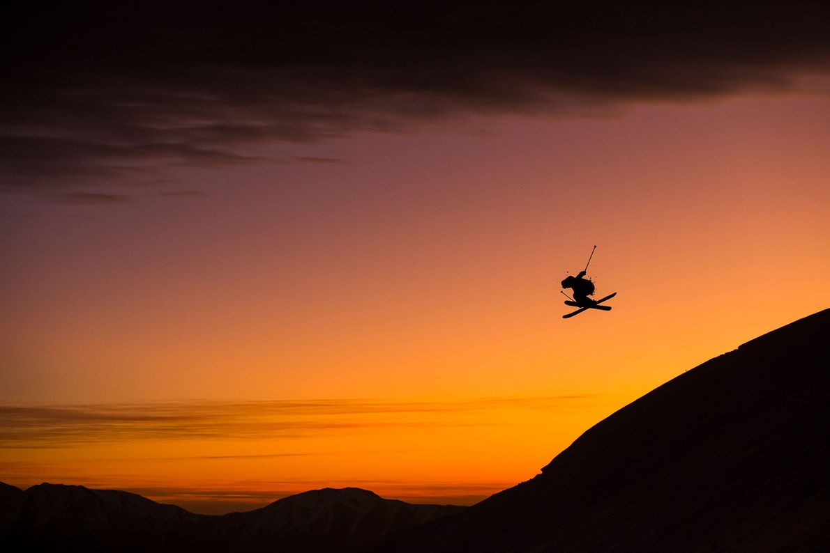 A skier jumps off a peak at the Farellones Ski Resort near Santiago, Chile. The relatively ...