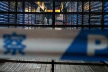 Members of the Wuhan Hygiene Emergency Response Team conduct searches on the closed Huanan Seafood Wholesale ...