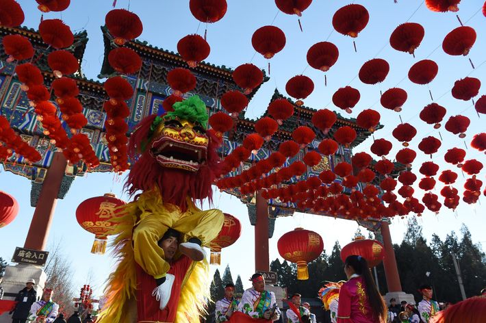 Lion dancers perform during the opening ceremony of the Ditan Park temple fair on the eve ...