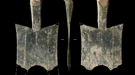 Spade-shaped coins, unearthed at the site of an ancient bronze foundry in China's Henan Province, are ...