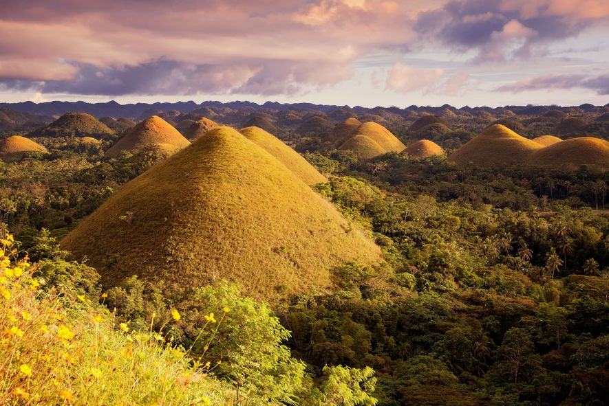 The Chocolate Hills are a unique geological formation in the Bohol, Philippines. Taken during sunset.