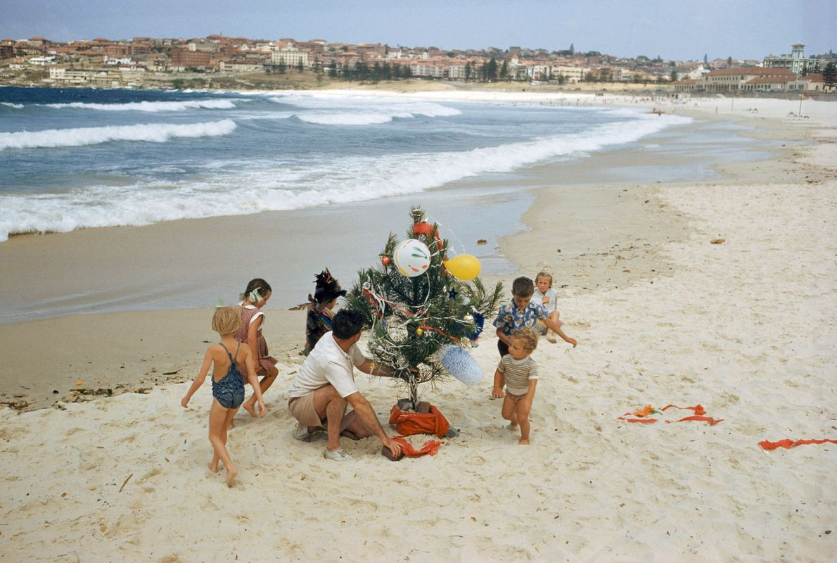 An Australian family decorates a Christmas tree on Bondi Beach in Sydney in 1956.