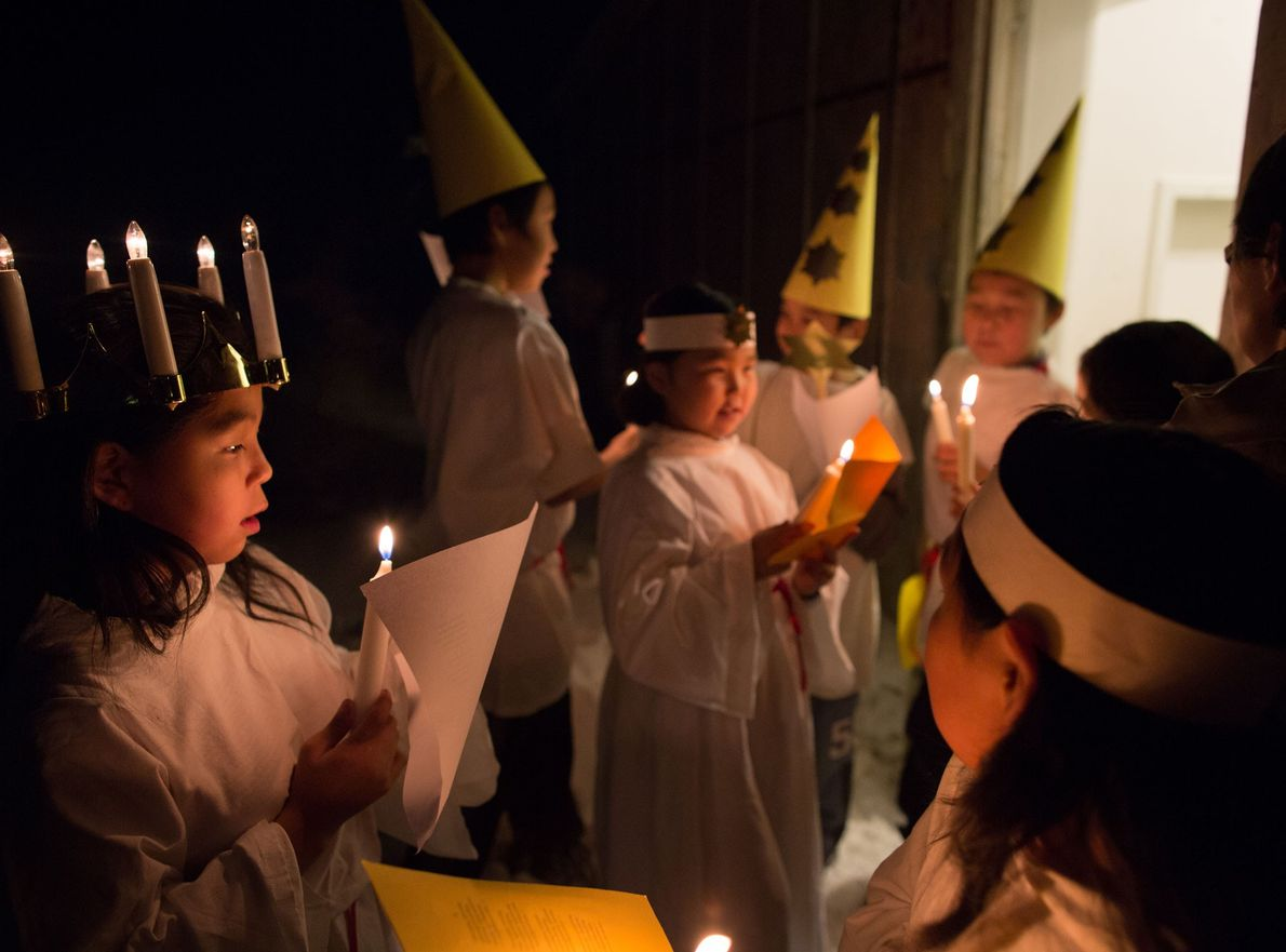 Children participate in a 2013 school Christmas celebration in the small Inuit settlement of Isortoq, Greenland.