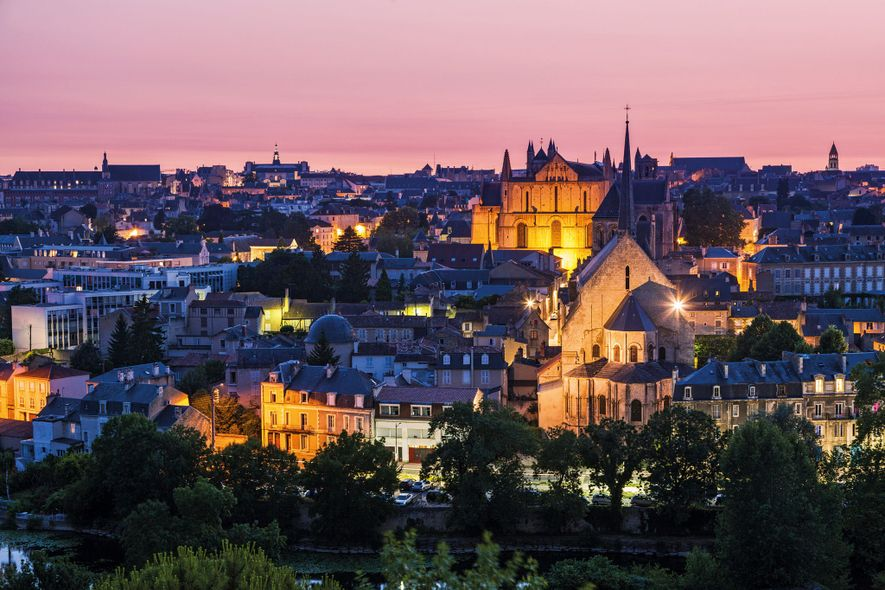 The Romanesque Church of Sainte-Radegonde rises in the foreground of this image of Poitiers, the birthplace ...