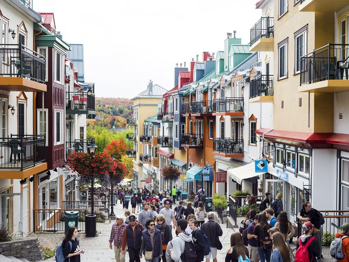 Visitors walk past shops and restaurants in the resort town of Mont-Tremblant.