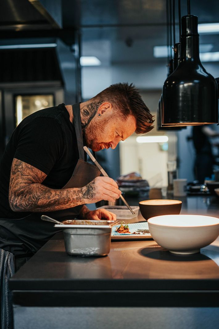 Tommy Heaney plating up  in the kitchen