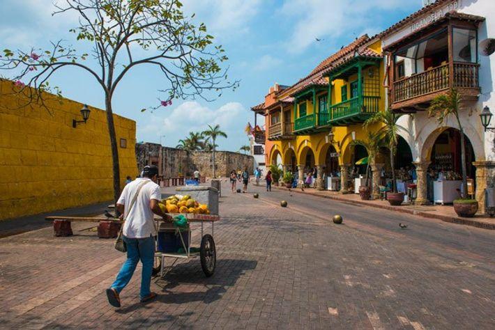 Fruit vender pushes a cart in Cartagena
