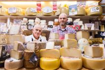 Father and son owners greet regular customers at Formaggeria Barbieri in Mercato delle Erbe.