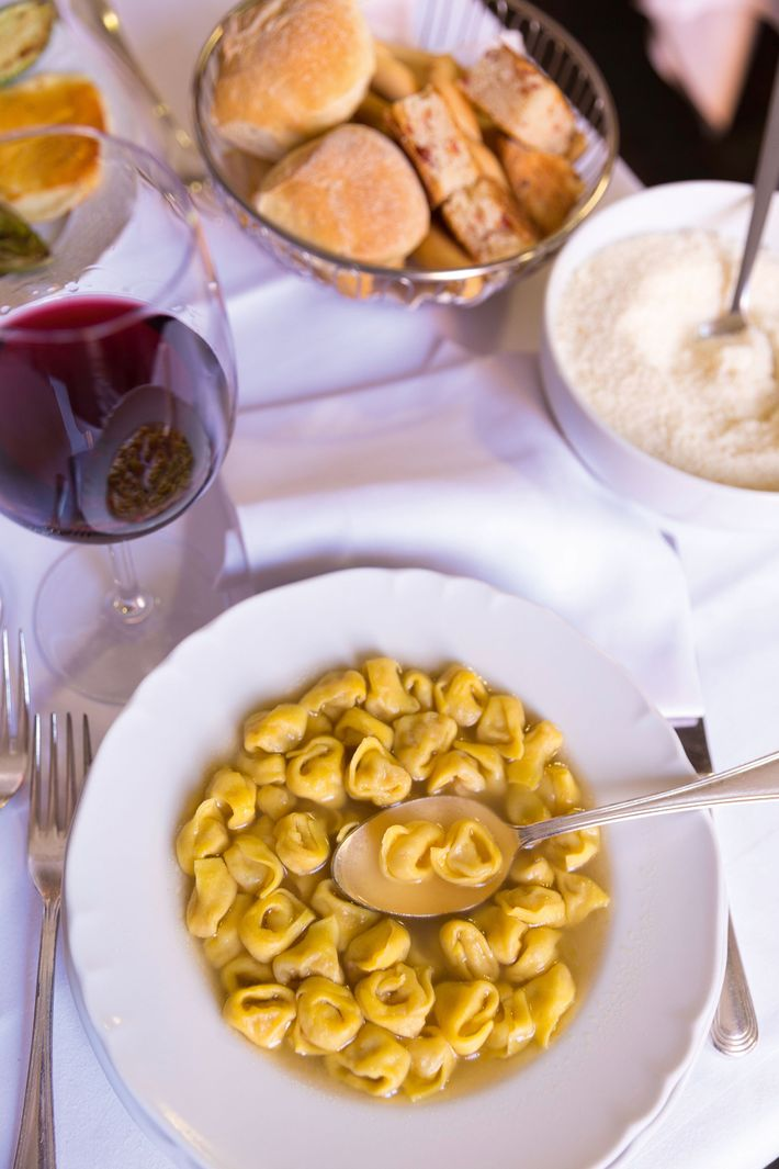 Tortellini in brodo — tiny, hand-twisted pasta filled with parmesan and various pork meats, swimming in ...