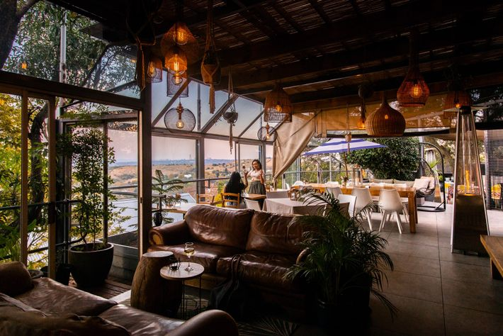 Pablo House's spacious terrace has wonderful views over one of the few ridges in the city ...