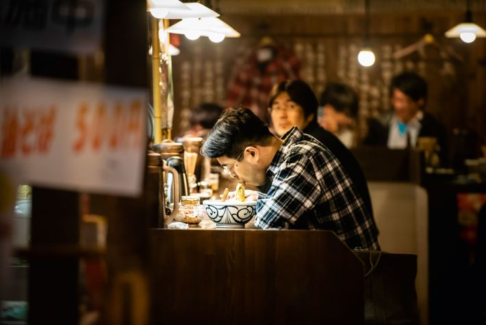 Dining on noodles in Kuromon Ichiba Market, also known as 'Osaka's Kitchen' thanks to its abundance ...