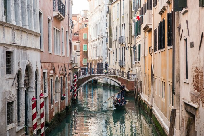 A gondola passes through a quiet canal near St Mark's Square. A boat trip down the city's ...