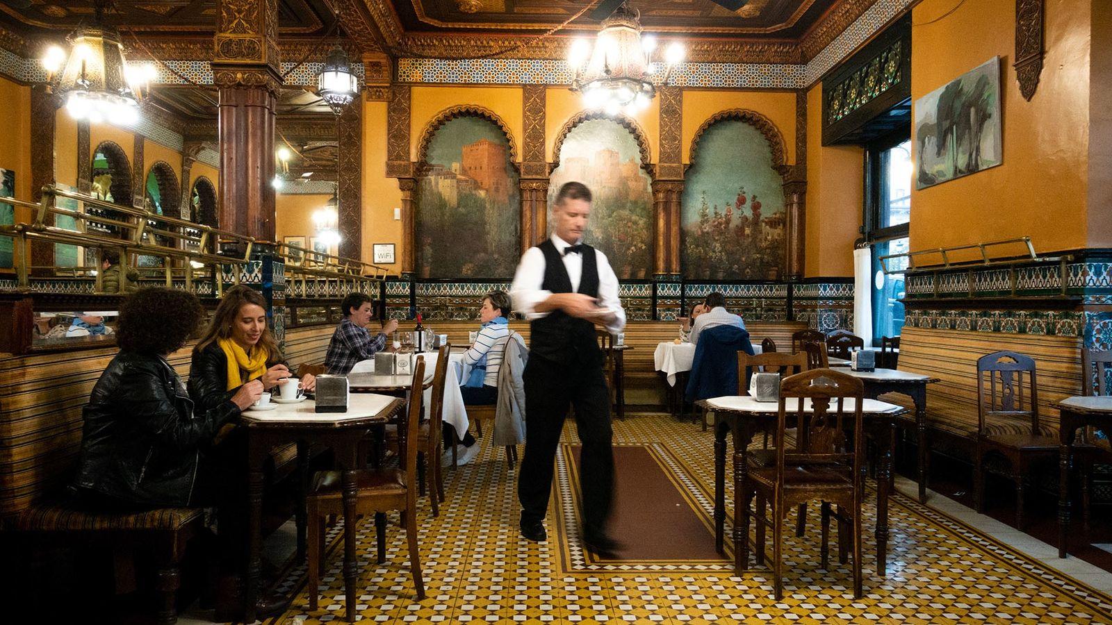 Overlooking the Jardines de Albia since it opened its doors in 1903, Café Iruña still feels like ...
