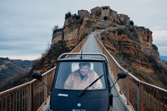 Tony Costa Heywood, one of seven remaining inhabitants of Civita, crosses the footbridge to Civita's sister ...