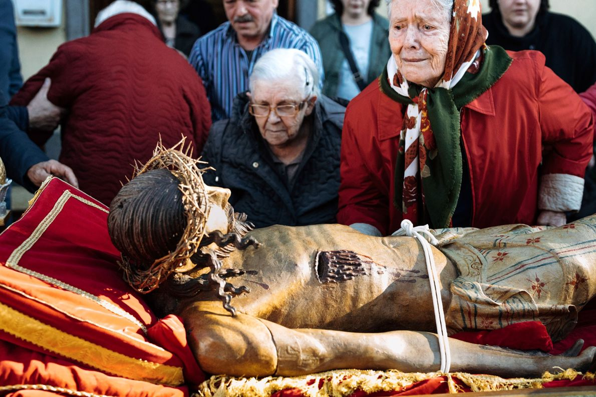 Traditionally, the Good Friday procession stops at a nursing home in Bagnoregio where elderly people kiss ...