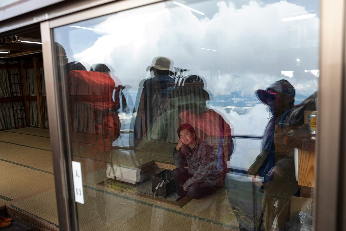 Groups of climbers pass coffee shops and lodges on their way up.