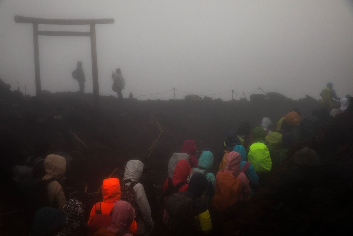 Scores of climbers slowly make their way towards the summit.