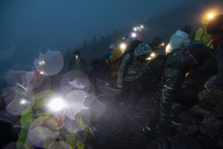 "People start climbing to the summit of Mount Fuji in the early morning hours. ""You look ..."