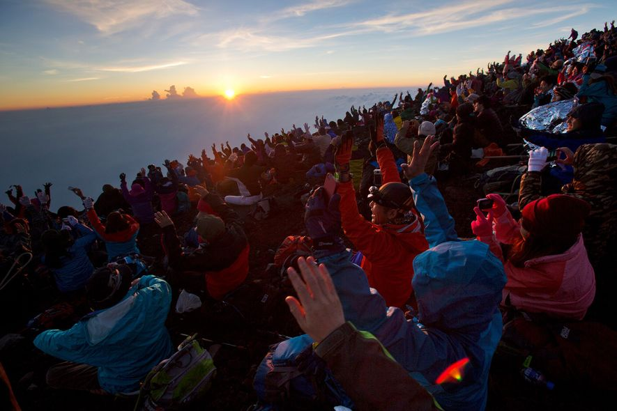 "Guttenfelder recalls the first time he summited Mount Fuji. ""When the sun rose, thousands of people ..."