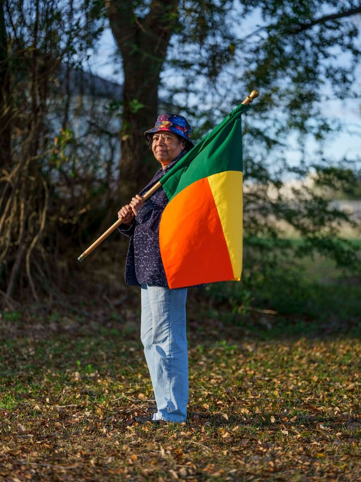 Patricia Frazier carries the flag of Benin, the modern nation once ruled by the kingdom of ...