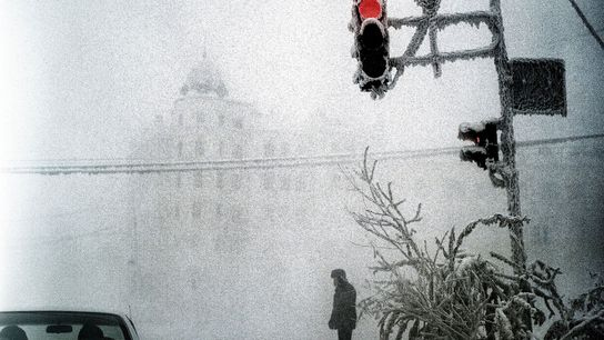 A lone figure stands on a street corner in Yakutsk, Siberia. Photographer Steeve Iuncker was able ...