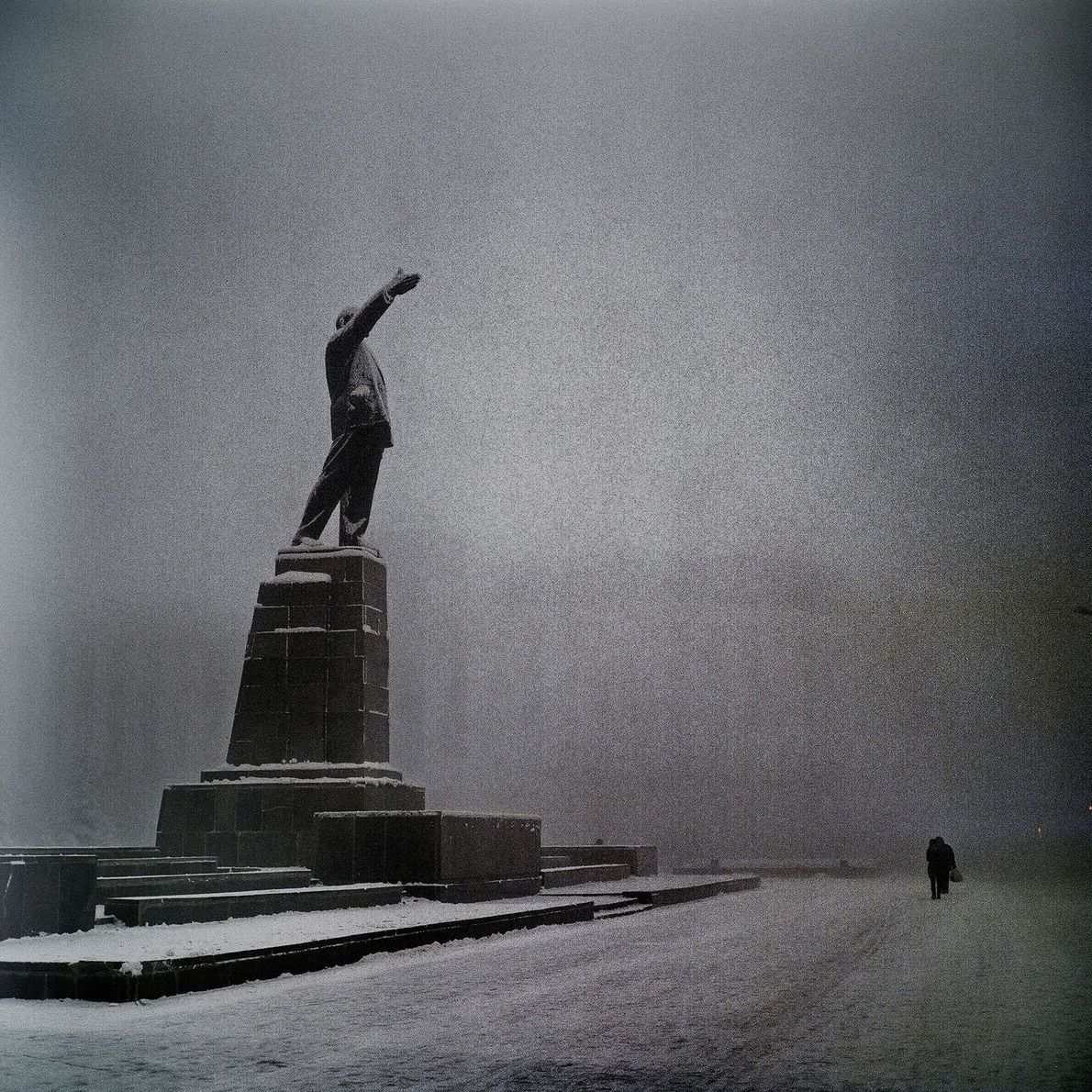 A statue of Lenin keeps watch over the empty Lenin square.