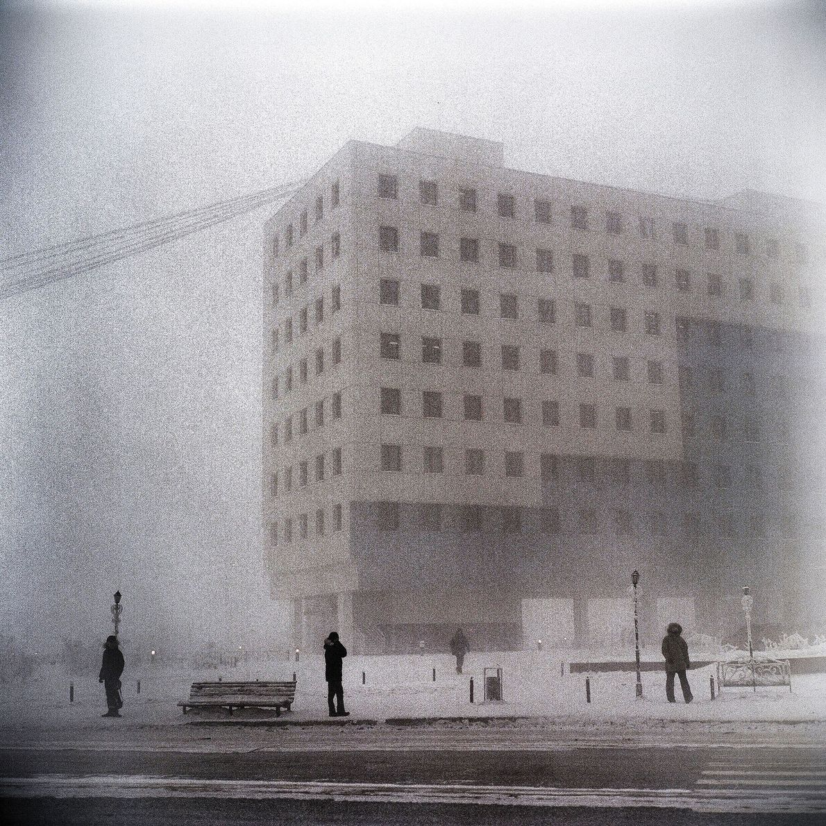 Thick, icy fog shrouds the city.