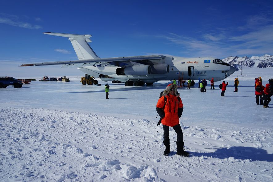 O'Brady stands near a plane during a past trip to Antarctica.