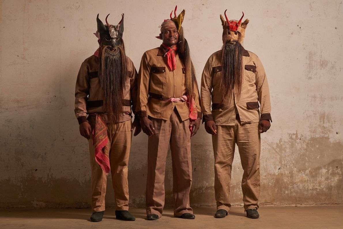 Afro-Mexican men from Collantes wear masks for the Dance of the Devils. The masks are made ...