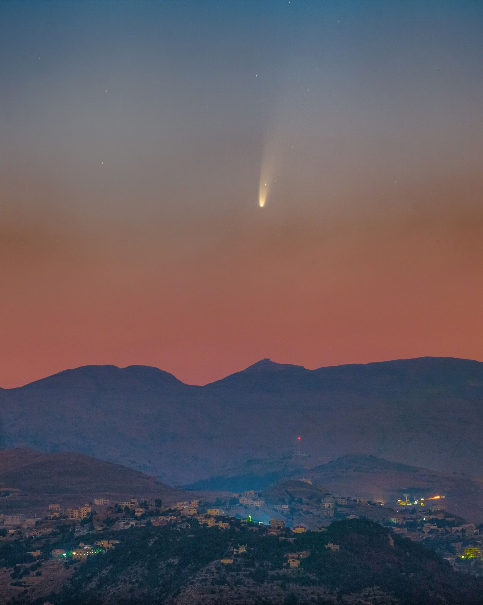 Comet NEOWISE was captured over Lebanon in this composite image, composed of photos taken on July ...