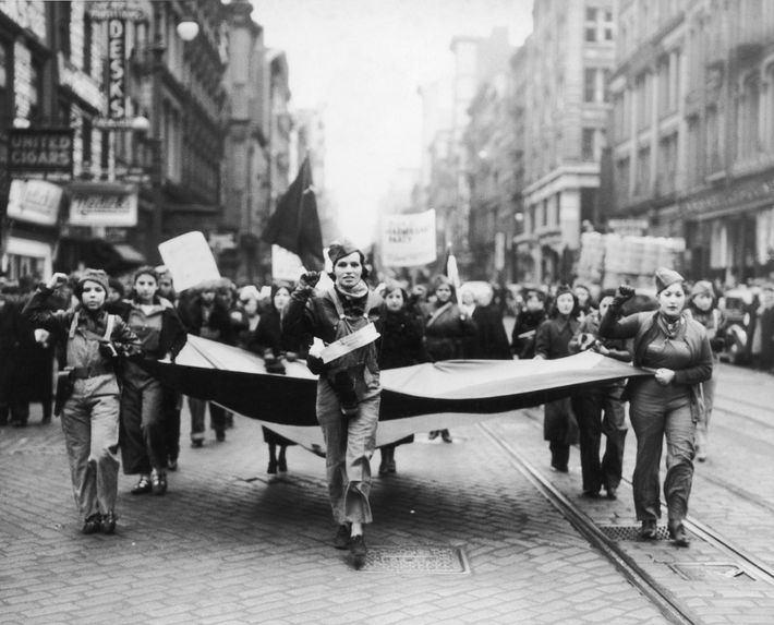 Female communists march past the German consulate in New York City in 1938 to express support ...