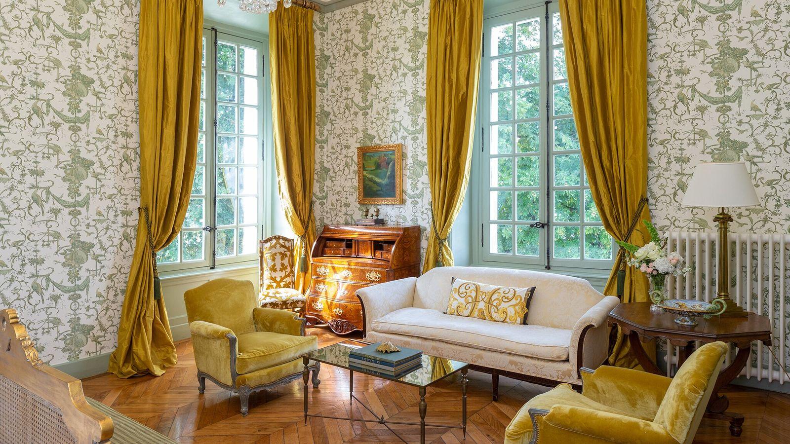 The Corner King Suite at Hotel Château du Grand-Lucé has views out towards an beautiful belle époque-style ...