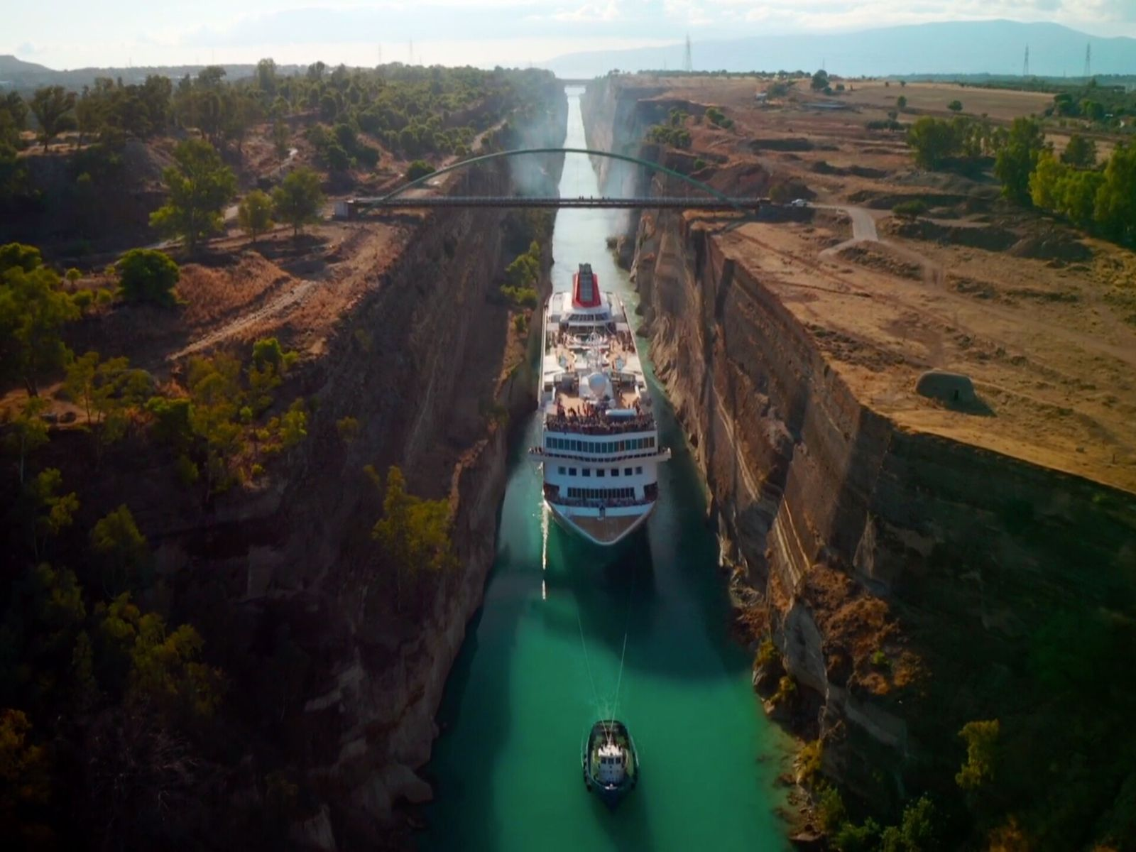 Mesmerising footage shows the ancient waterway allows passage with as little as one metre on each ...
