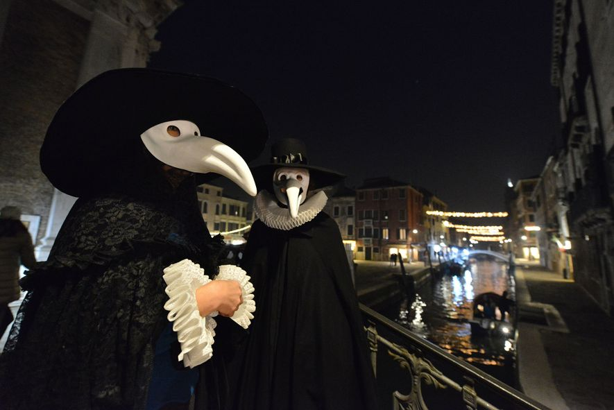 """Masked revellers were able to participate in the """"Plague of Doctors Procession"""" during Carnival, before the ..."""