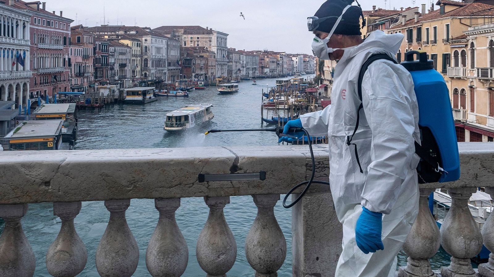 Workers in Venice disinfected sites (the Rialto Bridge pictured here), a day after Italian Prime Minister ...