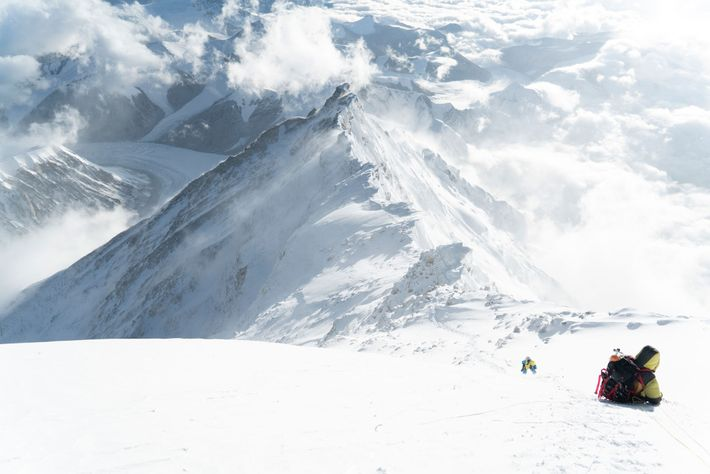 Climbers ascend the final snow pyramid on the North Side of Everest. The entirety of the ...