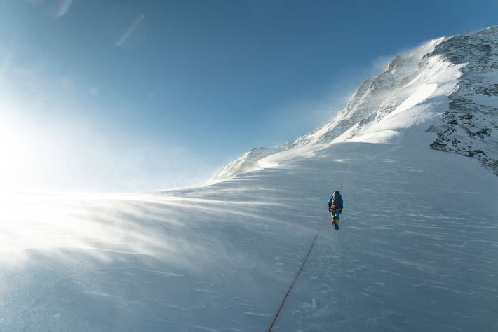 A climber ascends through windy conditions on the standard North Ridge route on Everest's Tibetan/Chinese side. ...
