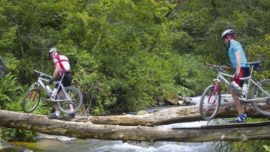 Cyclists cross a stream