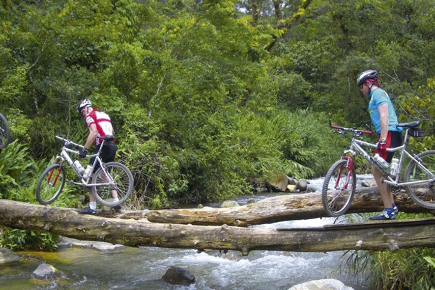 Cyclists cross a stream